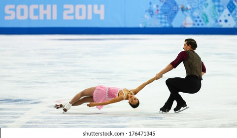 Sochi, RUSSIA - February 11, 2014: Felicia ZHANG and Nathan BARTHOLOMAY (USA) on ice during figure skating competition of pairs in short program at Sochi 2014 XXII Olympic Winter Games