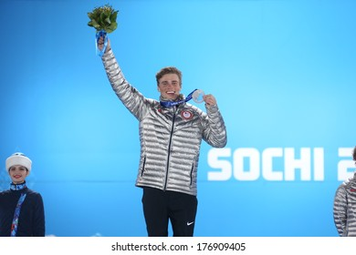 SOCHI RUSSIA - February 13TH: Gus Kenworthy stands on the Olympic Podium with a silver medal in the Olympic park on February 13th, 2014 in Sochi, Russia.