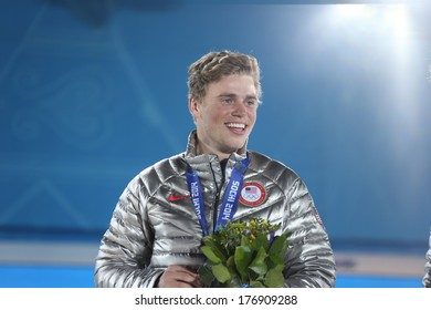SOCHI, RUSSIA- February 13th: skier Gus Kenworthy accepts his silver medal at the Olympic park  on February 13th 2014 in Sochi Russia.