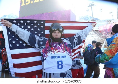 SOCHI, RUSSIA- February 13th: skier Gus Kenworthy celebrates with an American flag after winning a silver medal in ski slopestyle on February 13th 2014 in Sochi Russia.