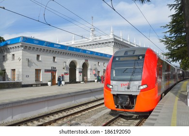 SOCHI, RUSSIA - FEBRUARY 14, 2014: Lastochka high-speed train on the railway station of Sochi. Russian Railways provide free passenger transport on commuter trains in Sochi area during Winter Olympics
