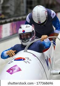 Sochi, RUSSIA - February 16, 2014: Korea 1 team at two-man bobsleigh heat at Sochi 2014 XXII Olympic Winter Games