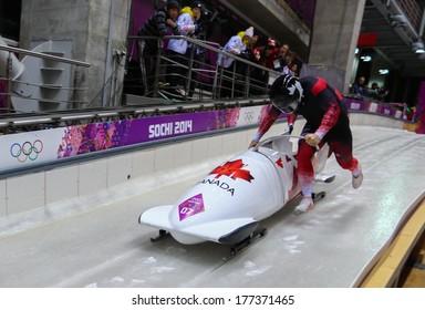 Sochi, RUSSIA - February 16, 2014: Canada 1 team at two-man bobsleigh heat at Sochi 2014 XXII Olympic Winter Games