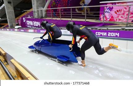 Sochi, RUSSIA - February 16, 2014: Romania 1 team at two-man bobsleigh heat at Sochi 2014 XXII Olympic Winter Games
