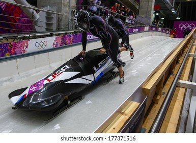 Sochi, RUSSIA - February 16, 2014: United States 3 team at two-man bobsleigh heat at Sochi 2014 XXII Olympic Winter Games