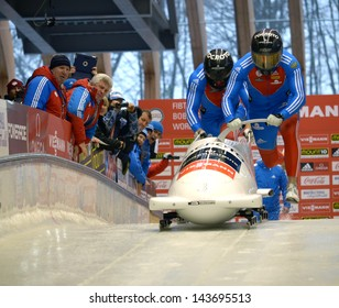 "SOCHI, RUSSIA - FEBRUARY 16: FIBT Viessmann Bobsleigh and Skeleton World Cup on February 16, 2013 in Sochi, Russia. Center Luge ""Sanki"". Team Russia on track."