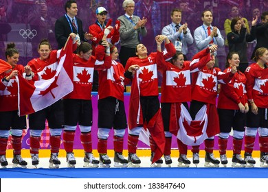 Sochi, RUSSIA - February 20, 2014: Canadian Women's Ice hockey team gold medalists, at medal ceremony after Gold Medal Game vs. USA team at the Sochi 2014 Olympic Games