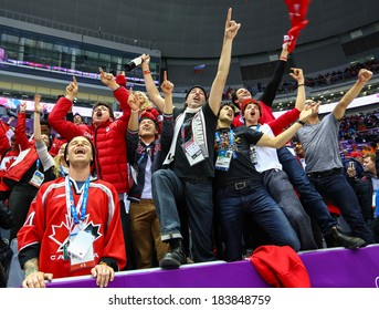 Sochi, RUSSIA - February 20, 2014: Fans of Canadian Women's Ice hockey team celebrates their team victory in Gold Medal Game vs. USA team at the Sochi 2014 Olympic Games