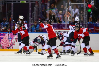 Sochi, RUSSIA - February 20, 2014: Canadian Women's Ice hockey team celebrating gold medals, after Gold Medal Game vs. USA team at the Sochi 2014 Olympic Games