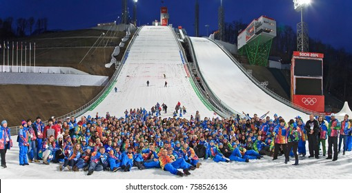 Sochi, Russia - February 20, 2014: Russian volunteer and Organizing Comittee team celebrating completion of Olympic competitions at RusSki Gorki ski jumps during 2014 Winter Olympic Games. Group photo