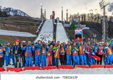 Sochi, Russia - February 20, 2014: Russian volunteer and Organizing Comittee team celebrating completion of Olympic competitions at RusSki Gorki ski jumps during 2014 Winter Olympic Games