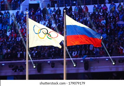 Sochi, RUSSIA - February 23, 2014: Olympic and Russian flag at closing ceremony in Fisht Olympic Stadium at the Sochi 2014 Olympic Games
