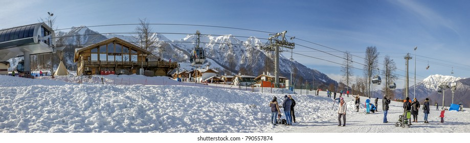 SOCHI, RUSSIA - JANUARY 3, 2018: Gondola lift on the background of snowy mountains. Rosa Khutor Resort