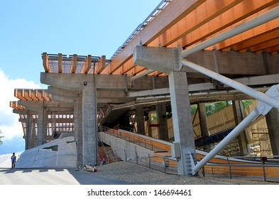 "SOCHI, RUSSIA - JULY 10:Construction of ""Sanki"" Luge Center for Winter Olympics 2014 on July 10, 2013 in Sochi, Russia. Capacity development 5000 spectators. To be used as the National Training Center"