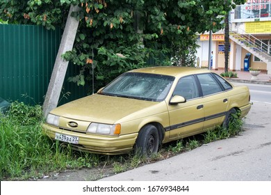 Sochi, Russia - July 18, 2009: Damaged motor car Ford Taurus in the city street.