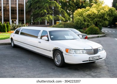 SOCHI, RUSSIA - JULY 19, 2009: White limousine Lincoln Town Car at the city street.