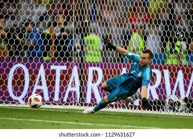 Sochi, Russia - July 7, 2018. Russian national football team goalkeeper Igor Akinfeev denying penalty from Mateo Kovacic during penalty shootout in World Cup Quarter-final Russia vs Croatia.