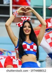 Sochi, Russia – July 7, 2018. Beautiful Croatian fan girl showing a heart sign at FIFA World Cup 2018 quarter-final Russia vs Croatia in Sochi