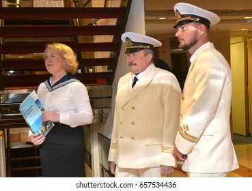 SOCHI, RUSSIA - June 11, 2017: The staff of the cruise liner Prince Vladimir meets passengers on the inner deck. The ship today set off for the first flight from Sochi.
