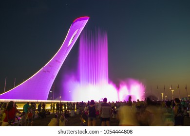 "SOCHI, RUSSIA - JUNE 22, 2016: Bowl of the Olympic flame ""Firebird"" and singing Fountain in the Olympic park in the evening. The main symbol of the Olympic Games of 2014 in Sochi"