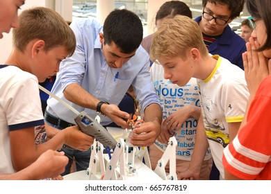 "SOCHI, RUSSIA - June 24, 2017: Middle-aged students with a teacher complete the construction of a robot in an open lesson of the All-Russian Educational Center ""Sirius"""