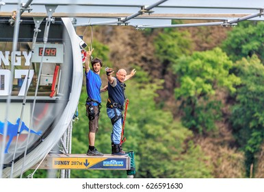 Sochi, Russia - June 7, 2015: Man with go pro camera on his wrist is about to jump 207 meter bungy at AJ Hackett Sky Park on mountain forest background. Extreme activities of Sochi mountain resort