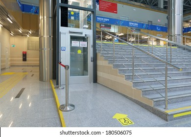 SOCHI, RUSSIA - MAR 5, 2014: Elevator for people with disabilities at the railway station in Krasnaya Polyana - equipment for successful Paralympic winter games