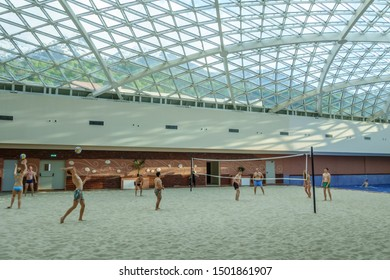 Sochi, Russia - May 2, 2014: The Mountain Beach Water Park in Gorky Gorod resort. People play beach volleyball on sand. Interior view