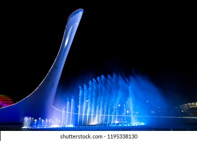 Sochi, Russia - November 19, 2017: Bowl of the Olympic flame Firebird and singing Fountain in the Olympic park in the evening. The main symbol of the Olympic Games of 2014 in Sochi
