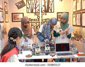 SOCHI, RUSSIA - November 21, 2014: Musulman girls competes at the robot Olympiad in Sochi . Here there was the World Robotic Olympiad 2014. It was attended by delegates from 47 countries.