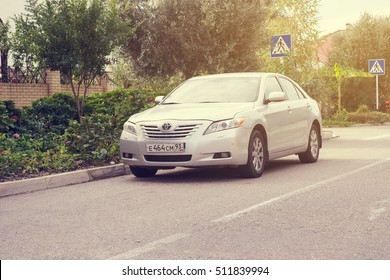 Sochi, Russia - October 11, 2016: Toyota Camry parked on the street of Sochi City, suburb.