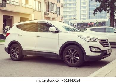 Sochi, Russia - October 11, 2016: New white Hyundai Santa Fe parked on the street of modern tile Sochi City.