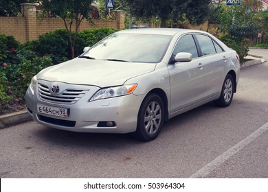 Sochi, Russia- October 12, 2016: Toyota Camry parked on the street of Sochi City, suburb.