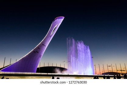 """SOCHI, RUSSIA - OCTOBER 18, 2016: Bowl of the Olympic flame """"Firebird"""" and singing Fountain in the Olympic park in the evening. The main symbol of the Olympic Games of 2014 in Sochi"""