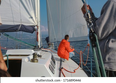Sochi , Russia - October 2019 . A group of people sailing on the yacht in the sea preparing for regatta .