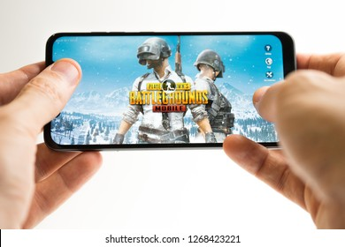 SOCHI, RUSSIA-DECEMBER 25, 2018: A man is playing in PUBG FPS game on smartphone