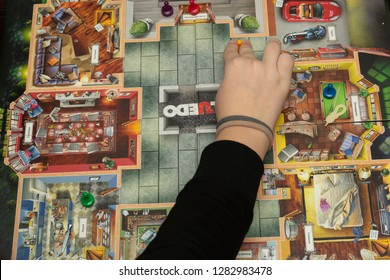 SOCHI, RUSSIA-JANUARY 12, 2019: A girl is playing in board game Cluedo