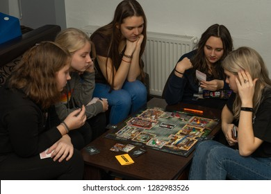 SOCHI, RUSSIA-JANUARY 12, 2019: A girls is playing in board game Cluedo