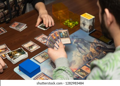 SOCHI, RUSSIA-JANUARY 12, 2019: A man is playing in board game Magic: The Gathering