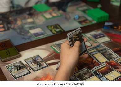 SOCHI, RUSSIA-MAY 17, 2019: A man is holding game cards in board game Magic The Gathering - War of the Spark