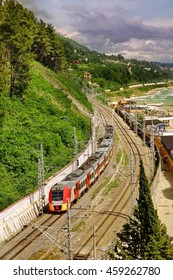 Sochi, Russian Federation - June 01, 2016: Russian Railway.  High Speed Electric Express Train Running Along The Black Sea Shore Beach. Train Direction From Sochi City To Dagomys Railway Station.