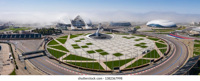 Sochi,Russia- 27 APR 2019 Early in the morning over the Olympic Park Sochi fell heavy fog from the black sea. Aerial photography with quadrocopter.The Fisht stadium, the Olympic flame into the clouds.