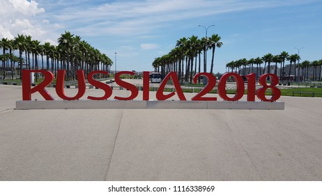 Sochi/Russia - June 11, 2018: Inscription Russia 2018 to the World Cup, in the city square on the background of palm trees and blue sky