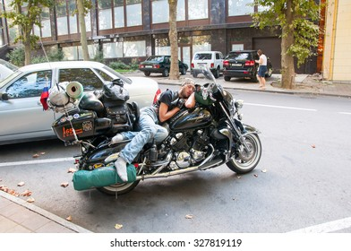 Sochi,Russia-September 02: Undefined biker have a rest on his mororbike on September 02, 2015 in Sochi city, Russia. Sochi is a city in Krasnodar Krai, Russia, located on the Black Sea coast.