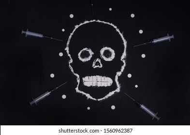 Social advertisement. The concept is death from drugs. Skull made of white powder on a black background with syringes and pills. For young people.