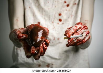 Social advertising and tobacco control: bloody hand holding a cigarette smoker and bloody human heart
