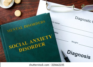 Social anxiety disorder  concept. Diagnostic form and book on a table.