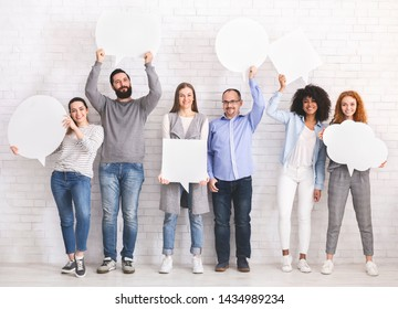 Social comments. Group of diverse people holding blank speech bubbles, empty space