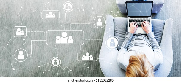 Social Connections with man using a laptop in a modern gray chair