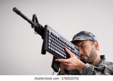 Social Cyber Warfare. Army Soldier Using Computer Keyboard